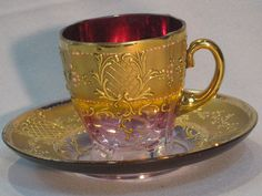 look the cup has little feet. I would love to drink my tea out of this every day.  Moser Bohemian Glass Cup And Saucer.... ruby lane