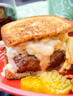 Grilled Reuben Burgers are smothered in sauerkraut, Havarti cheese, and Thousand Island dressing. Pairs wonderfully with CK Mondavi and Family Merlot!