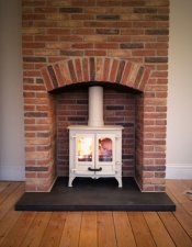 Charnwood Island 1 in almond, brick fireplace