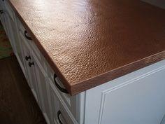 Copper countertop edge close up machine hammered finish