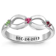 Infinity sign ring with the crystal birthstones of Mom, Dad and daughter. This setting glimmers with its pure polished Sterling Silver. You can also add a date to the inside of the band. $69.99
