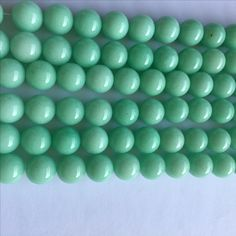 Dyed jade, round 10 mm. Tiffany colour.