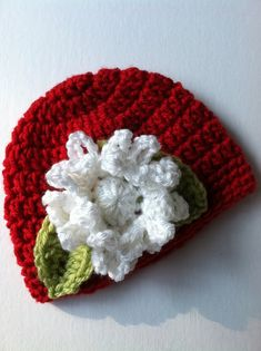 Red Crochet Baby Hat with Flower, Crochet Baby Hat, Newborn Hat, Baby Hat, Red Baby Hat, Hat with Flower, Baby Girl Hat, Christmas Hat. $22.00, via Etsy.