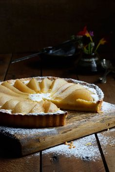 From The Kitchen: Pear and Almond Frangipane Tart. Partial view of the tart, note the lighting on the tart only and shadowed background, also the powdered sugar Just Desserts, Delicious Desserts, Dessert Recipes, Yummy Food, Pear Recipes, Sweet Recipes, Baking Recipes, Sweet Pie, Sweet Tarts