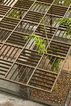 walkway pergola with grid shade