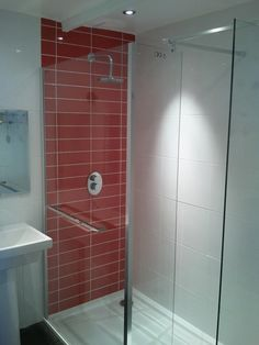 Bathroom shower with red tile backing. Make your home design dreams come true. Read reviews of 1000s of trusted tradesmen across the UK and get free quotes on MyBuilder.com.