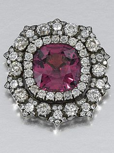 AN ANTIQUE SPINEL AND DIAMOND BROOCH, 1880s. Centring on a cushion-shaped spinel within a surround of circular-cut diamonds, composite. #antique #brooch