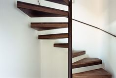House K Spiral Staircase Remodelista - I like the way the design uses the wall -- feels a bit more secure.