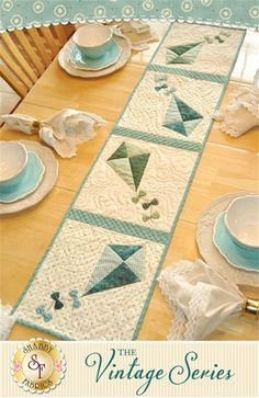 "The Vintage Series - July Table Runner Kit Decorate your home all year long with a beautiful table runner from The Vintage Series by Jennifer Bosworth of Shabby Fabrics. This applique kit is for the July design. Table runner measures approximately 12½"" x 53""."