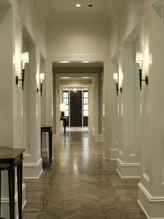 """wall sconce in hallway That sticks out more than 5"""" should be mounted at 6'-8"""" above the floor, just under the height of a door way. So that no one walks into it or hits their head on it, when trying to exit in a fire. It's trying to keep all people safe when they're trying to get out of the building. Google Search"""