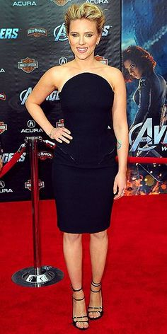 WHAT SHE WORE Scarlett Johansson added Van Cleef & Arpels diamonds and patent leather stilettos to her Versace peplum dress at the premiere of The Avengers.   WHY WE LOVE IT The actress channeled her inner Black Widow in a fierce, curve-enhancing LBD.