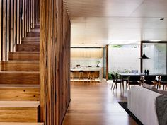 A compact yet spacious modern Melbourne home:Recycled tallowwood salvaged from an old bridge in NSW was used on the floors, window frames, cladding and balustrade.