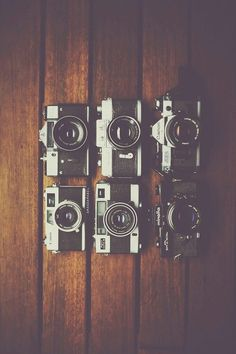 I love to collect vinyl records and vintage cameras. coincidence that I own the same camera in the photo<3