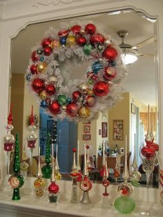 Vintage Christmas tree toppers and wreath look awesome. Christmas Mantels, Merry Little Christmas, Christmas Items, Christmas Love, Christmas Holidays, Christmas Wreaths, Christmas Villages, Victorian Christmas, Christmas Christmas