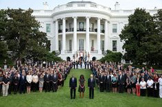 President Barack Obama, First Lady Michelle Obama and Vice President Joe Biden join White House staff on the South Lawn of the White House to observe a moment of silence marking the 13th anniversary of the 9/11 attacks, on September 11, 2014.