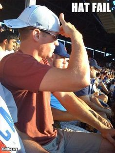 Baseball cap: You're doing it wrong. Not surprised though because I'm pretty sure this man is a cubs fan.