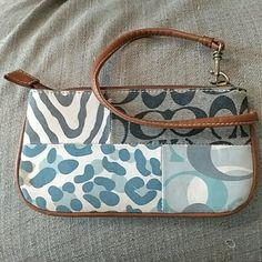 Coach Wristlet Used Coach Wristlet. Has wear on strap and stain in corner. Otherwise great!! Coach Bags Clutches & Wristlets