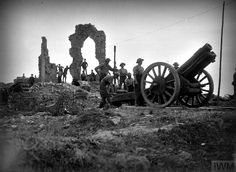 WWI, 23 August 1917; A 6-inch howitzer of the Royal Garrison Artillery ready for firing in the ruins of Pilckem. © IWM (Q 2751)