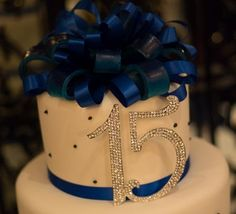 Royal blue and white quinceanera cake. The rhinestone decoration was purchased from ebay and given to the baker. During the party, we brought 1 candle to put on the cake for my daughter to make a wish and blow out! Don't forget the candle and for someone to light it! Gotta have your quince wish!! More pictures of this cake to come. www.quinceanerapride.com #quince #quinceanera