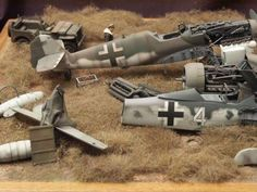 Aircraft graveyard diorama by Kay Koglin.  Notice the American pilot looking over the wreckage.