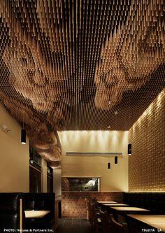 wood dowel ceiling at Tsujita LA Artisan Noodle. Interior design by SWeeT co., Ltd., Tokyo