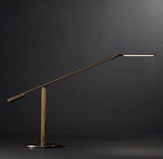RH's Equo Led Task Table Lamp:Form and function find a perfect union in this sleek task lamp. With its elegant counterweight design, the light is adjusted with just the touch of a finger.