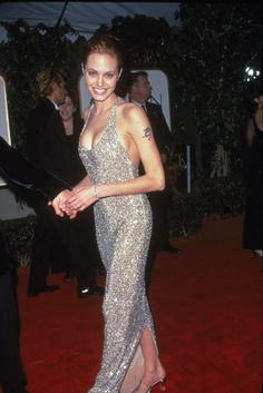 The Best Golden Globes Dresses of All Time: Glamour.comBest Golden Globes Dress: Angelina Jolie in Versace, 1999 During her wilder, pre-mama-to-many days, Angelina Jolie showed off her fab figure, daring style sense and edgy tattoos. This knockout sequined halter dress is just one of the many reasons why she'll always be a trendsetting style icon in our book.