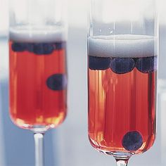 blueberries in pink champagne    If you used red and blue as your colors (blue dresses & nantucket reds) this would be so cool!