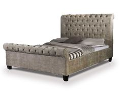 Luxuriously upholstered super kingsize bed frame with scroll finish at head and foot. Finished in a rich mink velvet fabric. FREE Delivery.