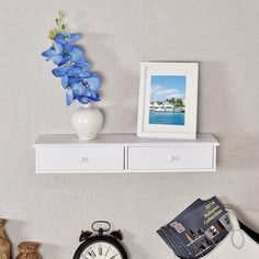 This Mounted Storage Floating Shelf, combining sturdy construction with a tidy and practical style, adds a fresh and gorgeous accent to the home. It's made of solid MDF, which is environment-friendly and resource-efficient. And this shelf comes with 2 drawers for storage and an open shelf over. It is perfect for holding your favorite books, collectibles, photos, toys, awards, CD's, videos, decorative items and more.