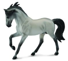 This fiery Andalusian stallion races across the arena in a breath-taking hand gallop. He is a light grey with black points and a windswept mane. He's even prettier in person than in the photo! Size: 6