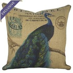 Burlap pillow with a perched peacock motif and typographic details. Handmade in the USA.  Product: PillowConstruction Material: Burlap cover and fiber fillColor: Blue and beigeFeatures:  Handmade by TheWatsonShopInsert includedHidden zipper closureMade in the USA Cleaning and Care: Dry clean