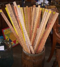 A display of vintage yardsticks. Love it. I love mine!!