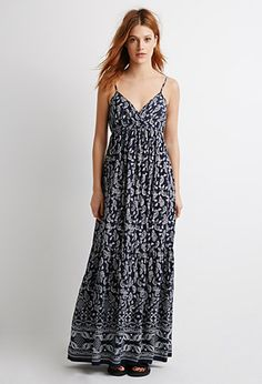 "Forever 21 Paisley Print Maxi Dress $28 : This floor sweeping maxi dress is your answer to easy dressing. An allover paisley print makes it a sure standout and with an elasticized band underneath the bust, this piece will have you feeling comfortable for hours on end. Adjustable cami straps, V-neckline Woven, unlined 100% viscose 49"" bust to hem, 30"" chest, 26"" waist Measured from Small"