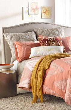Cozy coral bedding.
