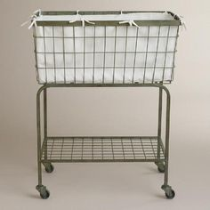 Vintage in style, our Ellie Rolling Laundry Cart is an attractive and functional laundry room solution. Featuring casters, this handy and spacious hamper rolls easily from room to room, making laundry time a little simpler. The lower tray is perfect for storing detergent or adding smaller baskets for extra storage.