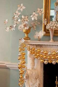 add ornaments to a strand of metallic beads to make your own super-unique garland--- use multiple ornament garlands and layer them