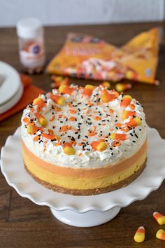 Decorating a luscious, easy-to-make Pressure Cooker Candy Corn Cheesecake sweetened with honey.