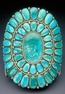 """#turquoise A gem since ancient times one of the oldest gem materials. Mined by Egyptians over 6,000 years ago, prized for sky blue color by Aztecs & Incas, later by the Native Americans. The name from Old French """"pierre Turquoise"""" or """"stone of Turkey,"""" reference to the considerable Persian turquoise sold in Turkish markets. Copper colors turquoise blue, iron impurities tint it green. This Navajo turquoise bracelet by Ondelacy is set in silver. / Smithsonian National Museum of Natural History…"""