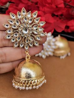 If you own valuable jewelry such as diamond earrings, pendants, diamond rings, or other great precious jewelry products, you can keep these products for a life time if you take care of them. Gold Jhumka Earrings, Indian Jewelry Earrings, Indian Jewelry Sets, Gold Bridal Earrings, Fancy Jewellery, Silver Jewellery Indian, Jewelry Design Earrings, Gold Earrings Designs, Ruby Earrings