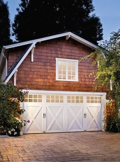 You'd never know it from the street but behind the house is a detached barn style garage with living space above. Doors: Clopay Coachman Collection Design 21 with SQ24 windows in white. www.clopaydoor.com
