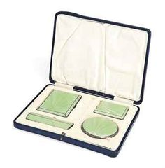 AN ART DECO FOUR-PIECE SILVER AND ENAMEL COMPACT SET MARK OF TURNER & SIMPSON, BIRMINGHAM, 1934