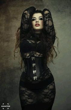 Gothic fashion model La Esmeralda wearing a bunch of black lace augmented by a black corset