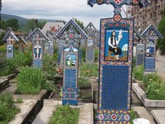 Romania. Colorful cemetery where tombstones depict how the person died. #Romania #cemetery