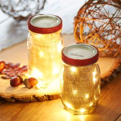 Add extra light and flair to your Fall decor by adding LED lights and burlap to Mason Jars