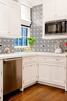 White small kitchen with Moraccan style mosaic tile backsplash. White roman shade with black trim covering kitchen window. http://cococozy.com