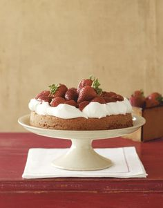 Celebrate summer with fresh strawberries and billows of cream on this moist cake.