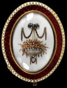 Enamelled gold clasps with ivory plaques painted in watercolour set with hair and rose cut diamonds. England 1775-1800