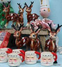 Vintage Christmas decorations and Santa mugs.