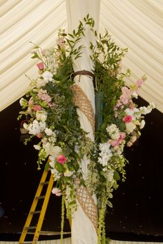 Pole decorations for a marquee